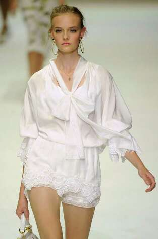 A bright white outfit with lace embellishment from Dolce & Gabbana for spring summer 2011.