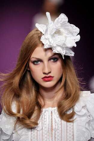 Andrew Gn works white eyelet into a hair accessory and more frilly white into a spring summer look. Photo: X