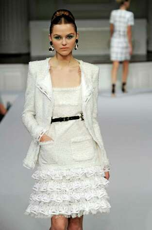 Oscar de la Renta's white knubby jacket and dress with bright white tiered ruffles