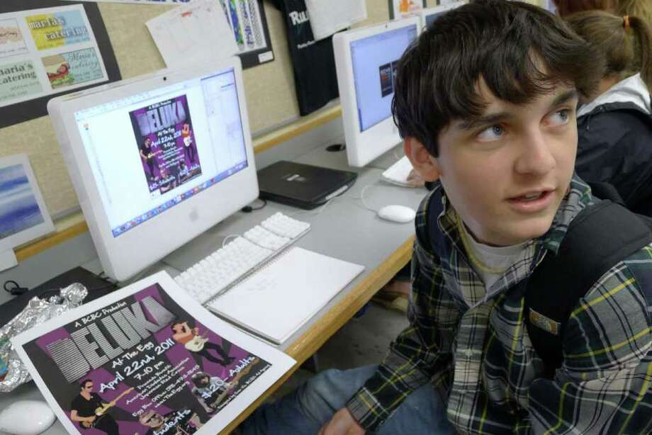 Sam Vis, a junior at Bethlehem High School, is among the students who designed posters for a fundraising concert, scheduled for Friday at The Egg, headlined by the indie rock band Deluka. (0Michael P. Farrell / Times Union) Photo: Michael P. Farrell / 00012757A