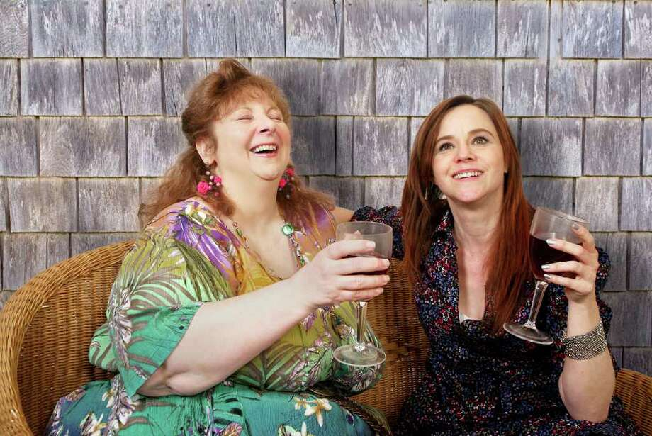 """Jodie Lynne McClintock, left, plays Joan, and Mhari Sandoval plays her sister Cathleen in the play """"Kingdom of the Shore,"""" opening April 27 at Capital Repertory Theatre in Albany. (Joseph Schuyler)"""