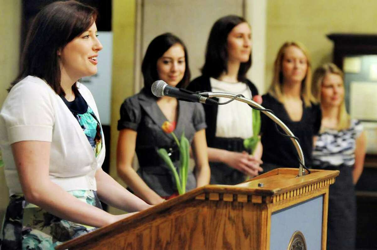 Tulip Queen finalist Katie Headd, 22, of Alban takes her turn at the microphone at a news conference on Wednesday, April 20, 2011, at City Hall in Albany, N.Y. Joining her are the other four finalists, from second left, Kelly Landers, 19, of Latham; Hannah Walker, 21, of Colonie; Marjorie Adriance, 18, of Knox; and Karen Colehour, 23, of Colonie. (Cindy Schultz / Times Union)