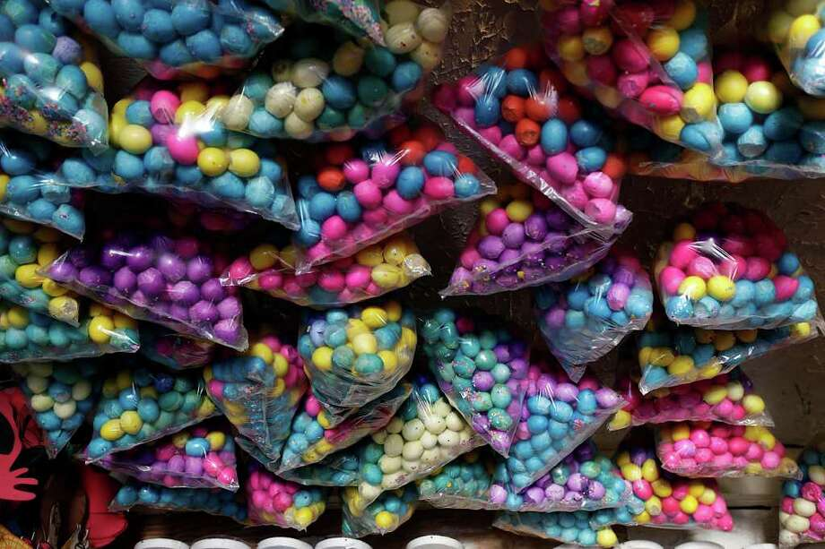 """METRO – Dozens of """"cascarones"""" are on display for sale at La Princesa Gift Shop, a store at 1301 Culebra, Tuesday, April 12, 2011. Although the store sells the eggshells year round, demand for the product goes up during the Easter Season.  JERRY LARA/glara@express-news.net Photo: JERRY LARA, SAN ANTONIO EXPRESS-NEWS / SAN ANTONIO EXPRESS-NEWS"""