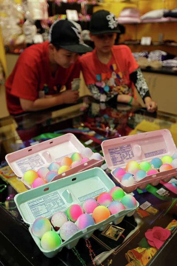 "METRO -- Daniel Codina (cq), 13, left, and his brother, Gabriel, shop for Fiesta medals by a ""cascaron"" display at the Fiesta Store on Broadway Ave., Tuesday, April 12, 2011. The egg shells are popular during Fiesta. JERRY LARA/glara@express-news.net Photo: JERRY LARA, SAN ANTONIO EXPRESS-NEWS / SAN ANTONIO EXPRESS-NEWS"