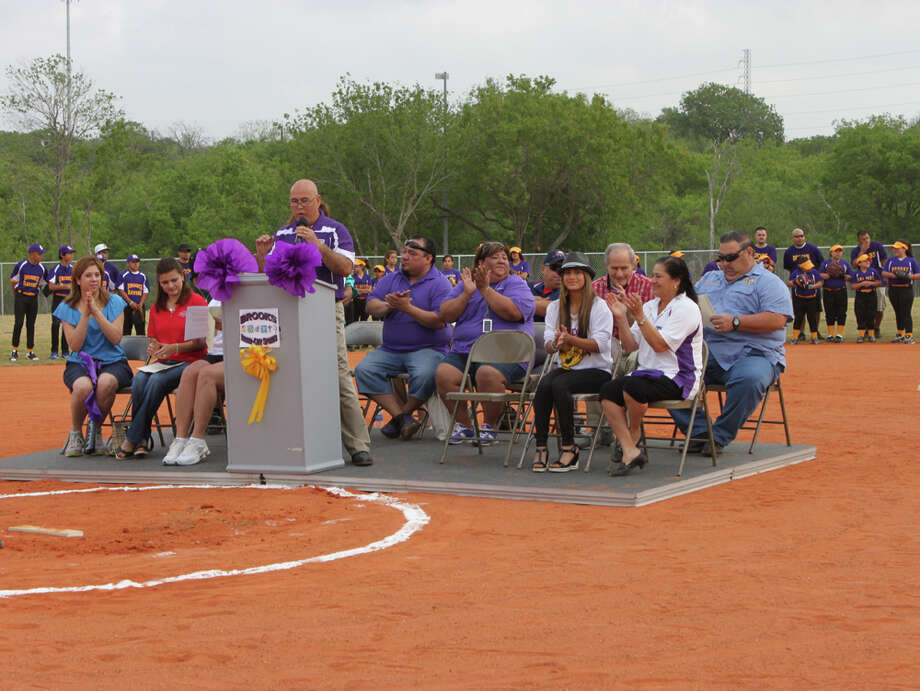 Ron Hayes, director of Brooks Inner City Sports welcomes guests during a ceremony to unveil the new baseball field at Paul Pytel Park. Photo: Ann Garcia