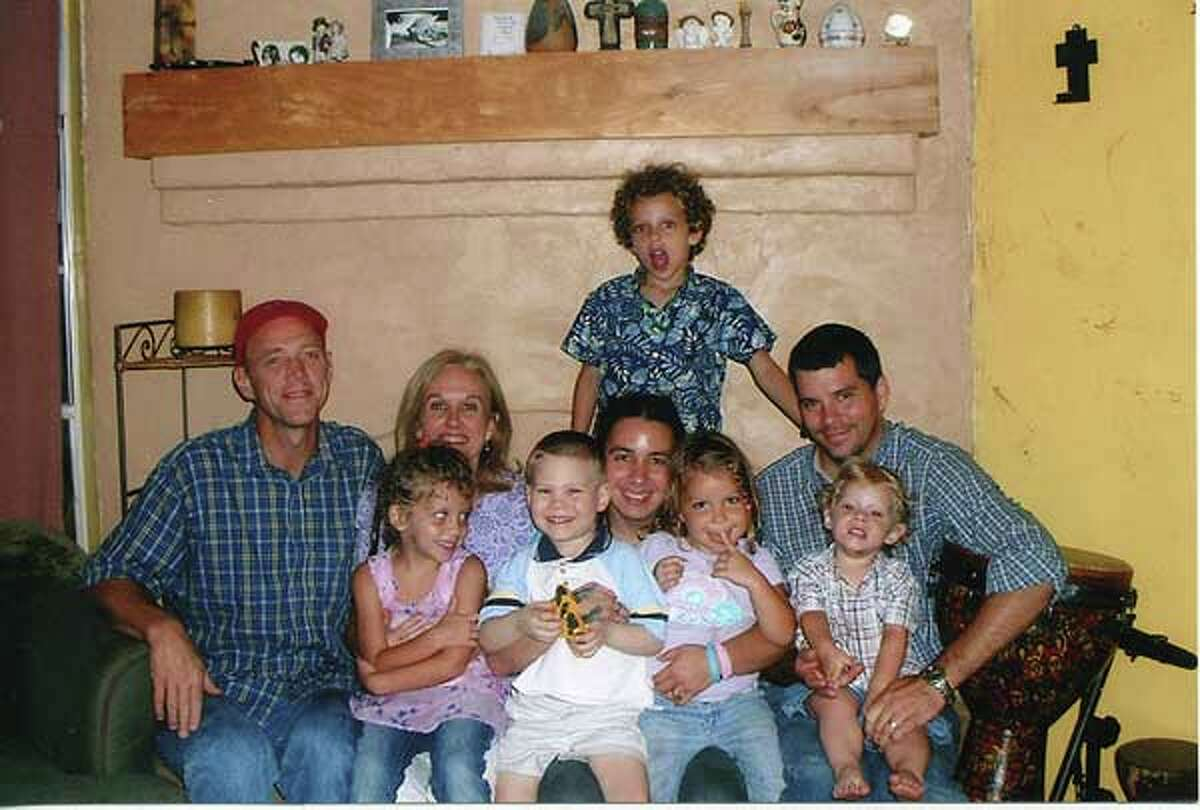Overton family, with Andrew Burd in front row, being held by Hannah Overton, on Mother's Day 2006. /Courtesy photo