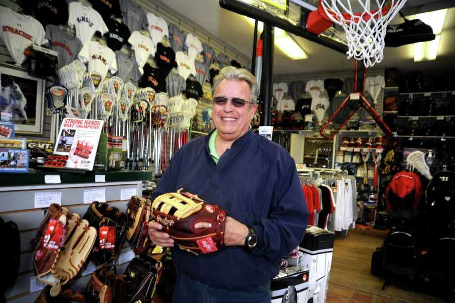Tom Bisanzo, owner of Bruce Park Sports, in Greenwich, celebrating 40 years in business, stands inside the store on April 20, 2011. Photo: Helen Neafsey / Greenwich Time