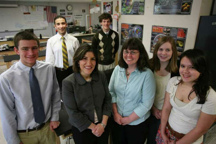 A team of Shelton High School students designed a cellular biology experiment that will be included in the Space Shuttle Endeavor mission on April 29. From left; Jame Szabo, 18, Omar Sobh, 17, Assistant Director for STEM education Tina Henckel, Jason Shnipes, 18, Teacher Mary Clark, Leann Misencik, 17, and Jessica Olavarria, 16. Photo: Brian A. Pounds / Connecticut Post