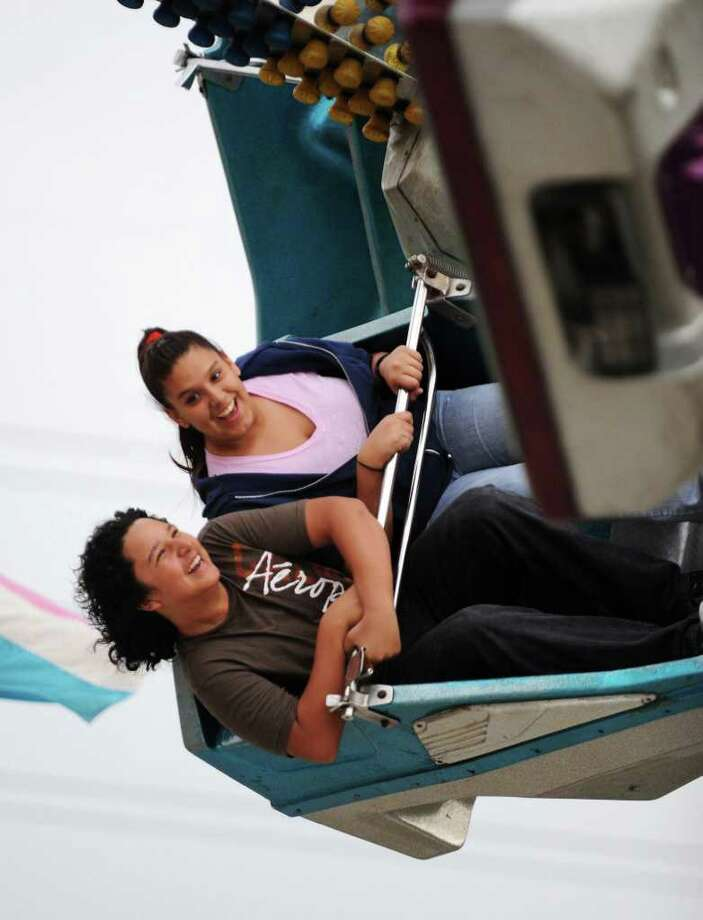 Two teens hold on during a wild carnival ride during last year's Kirby Fire Department's HoboFest. The 59th annual celebration kicks off April 29 for a four-day run. Photo: File Photo