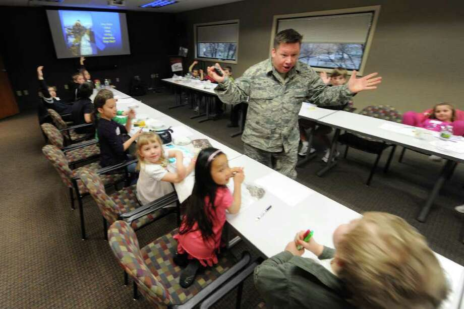"Msgt. William ""Willie"" Gizara uses his best theatrics to explain the mission of the 109th Airlift Wing to a group of youngsters gathered at the Cap Com Federal Credit Union in Colonie, N.Y. on ""Take Your Kid to Work Day"" on April 20, 2011. (Skip Dickstein/ Times Union) Photo: Skip Dickstein"