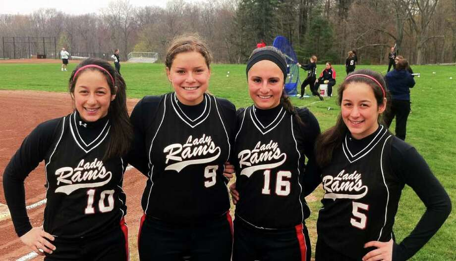 The New Canaan High School softball team has two captains who have played together for eight years and twins starting at pitcher and catcher. They are, from left, Cydney Ventura, Tory Rusch, Lindsey Schmid and Jordan Ventura. Photo: Dave Ruden / Stamford Advocate