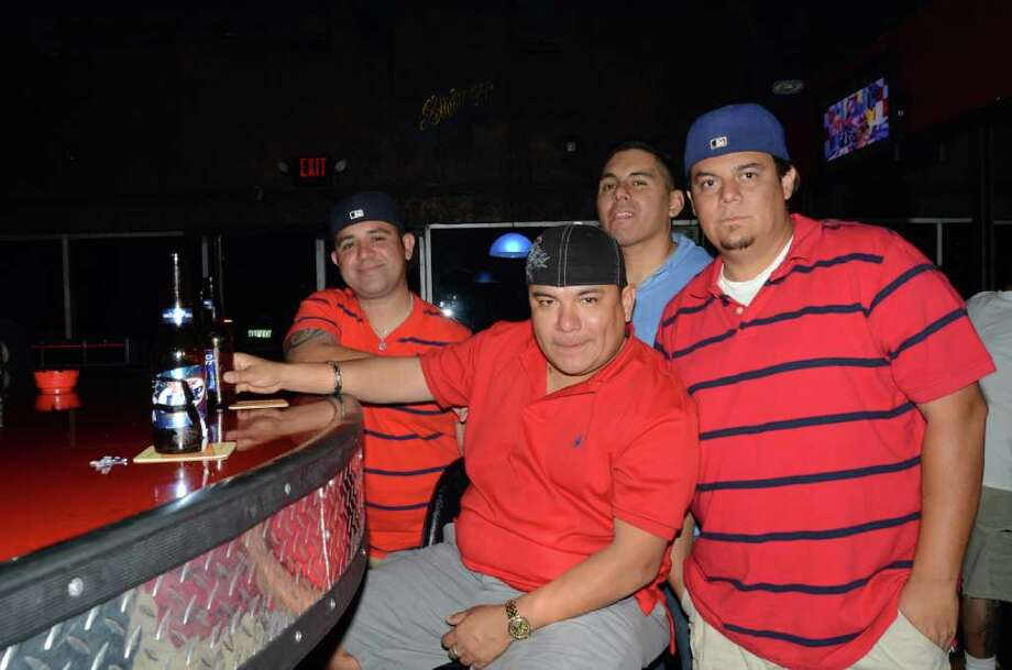 Mario Gonzalez (from left), Jay Yanez, Joe Gandara and Jesse Ruiz hit up their favorite bar, R Bar. ROBIN JOHNSON / SPECIAL TO THE EXPRESS-NEWS