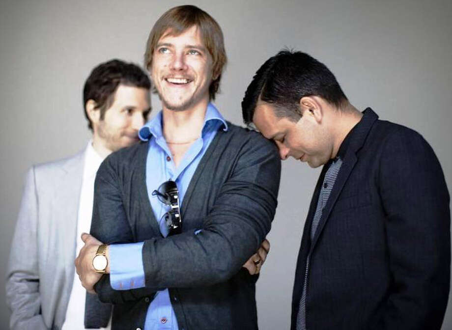 The New York rock band Interpol, which includes Daniel Kessler (from left), Paul Banks and Sam Fogarinio, makes both musical and fashion statements. COURTESY JELLE WAGENAAR