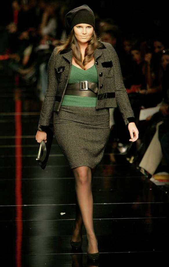 FILE - In this Feb. 17, 2007 file photo, a model wears an outfit part of Elena Miro' Women's Autumn-Winter 2007/2008 collection, at the Milan Fashion Week, in Milan, Italy. Using heavy fashion models instead of their size zero counterparts could make people fatter, a new study presented in London on Wednesday, April 20, 2011 says. Researchers say people who see bigger models on the catwalk could lose their own motivation to lose weight. (AP Photo/Alberto Pellaschiar) Photo: Alberto Pellaschiar / AP