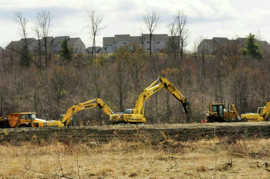 Work under way to clear land for new tracks and access bridge at the inermodal rail yard in Mechanicville, NY Thursday April 14,2011. ( Michael P. Farrell/Times Union ) Photo: Michael P. Farrell