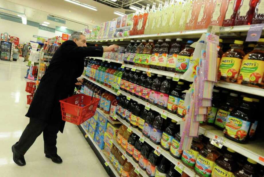 Albany County Legislature Tim Nichols  shops at the Hannaford Supermarket on Wolf Road in Colonie Feb.10, 2011.( Michael P. Farrell/Times Union ) Photo: Michael P. Farrell