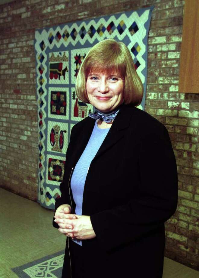Michele Monson, the former head of The Whitby School, shown here in a classroom in November 2000, has settled her sex discrimination lawsuit after a battle involving allegations that a group of powerful men forced her and other women out, and counterclaims that she mismanaged the school's finances and mistreated staff. Federal records show Michele Monson's lawsuit against The Whitby School was settled this week. Photo: File Photo / Greenwich Time File Photo