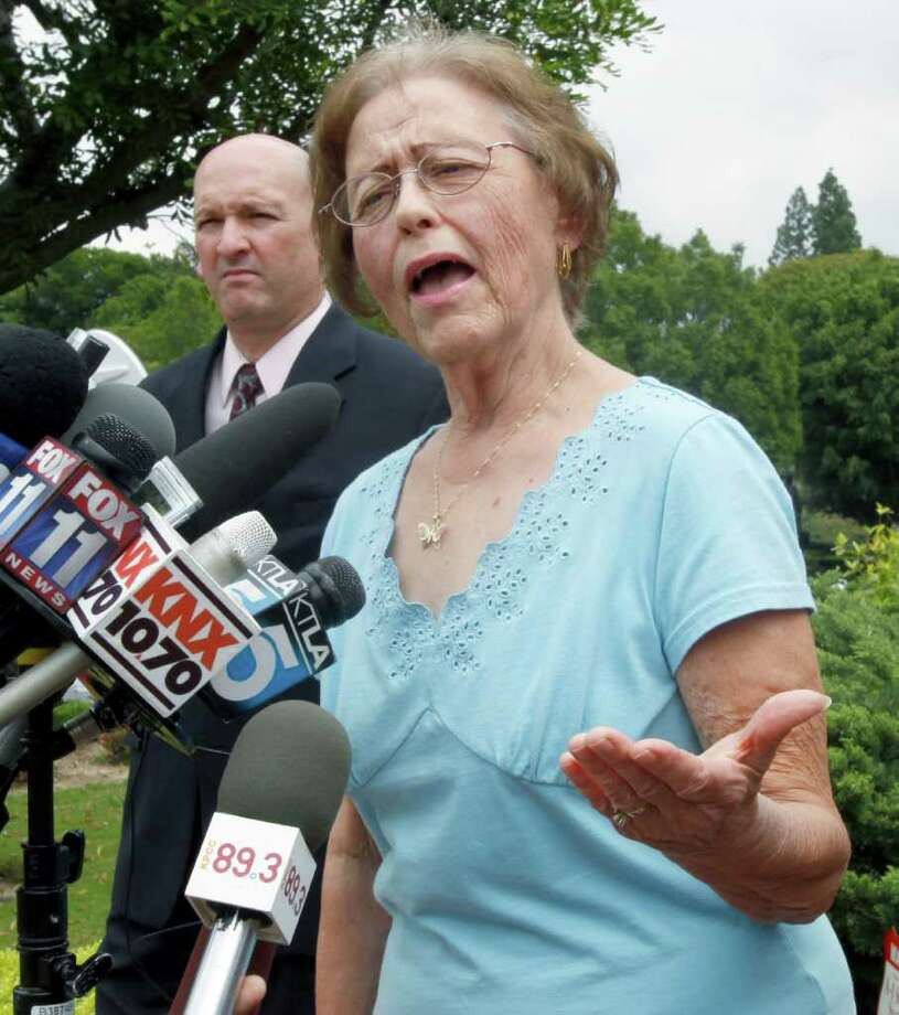 Marilyn Davenport, who forwarded an email depicting President Obama as a chimpanzee, issues an apology for those who found the work offensive but refuses to resign her position as an elected member of the Orange County Republican Central Committee, at a news conference outside her home in Fullerton, Calif., Wednesday, April 20, 2011. (AP Photo/Reed Saxon) Photo: Reed Saxon