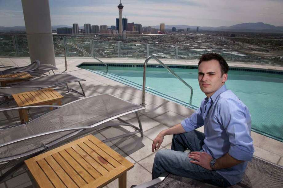 Professional online poker player Robert Fellner is seen on the roof of his apartment building north of the Las Vegas Strip, Tuesday, April 19, 2011, in Las Vegas. Fellner, who left his job at a New Jersey dry cleaners four years ago to move to Las Vegas and play online poker professionally, has seen his bankroll grow to $280,000. But since the government essentially shut down the poker industry with a prosecution against executives of the main companies, Fellner and others like him  worry they'll never see their money again. (AP Photo/Julie Jacobson) Photo: Julie Jacobson