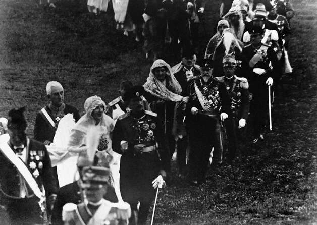 King Boris III of Bulgaria and and his bride Princess Giovanna followed by ex-King Ferdinand I of Bulgaria with Elena of Montenegro, the Queen of Italy: King Victor Emmanuel III of Italy, and other notables leaving church around Oct. 27, 1930. (AP Photo)