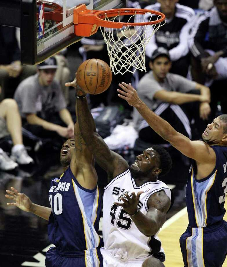 FOR SPORTS - San Antonio Spurs' DeJuan Blair grabs for a rebound between Memphis Grizzlies' Darrell Arthur and Memphis Grizzlies' Shane Battier during first half action of Game 2 of the first round of the Western Conference playoffs at the AT&T Center Wednesday April 20, 2011.  (PHOTO BY EDWARD A. ORNELAS/eaornelas@express-news.net) Photo: EDWARD A. ORNELAS, SAN ANTONIO EXPRESS-NEWS / SAN ANTONIO EXPRESS-NEWS (NFS)