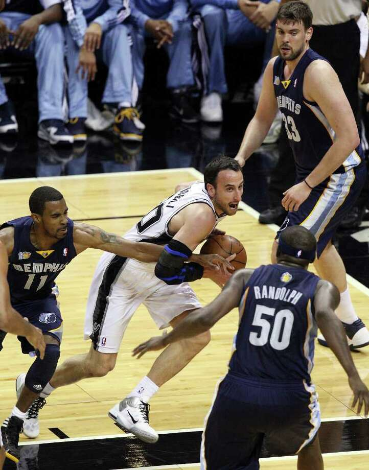 FOR SPORTS - San Antonio Spurs' Manu Ginobili drives to the basket between Memphis Grizzlies' Mike Conley, Zach Randolph and Marc Gasol during first half action of Game 2 of the first round of the Western Conference playoffs at the AT&T Center Wednesday April 20, 2011.  (PHOTO BY EDWARD A. ORNELAS/eaornelas@express-news.net) Photo: EDWARD A. ORNELAS, SAN ANTONIO EXPRESS-NEWS / SAN ANTONIO EXPRESS-NEWS (NFS)