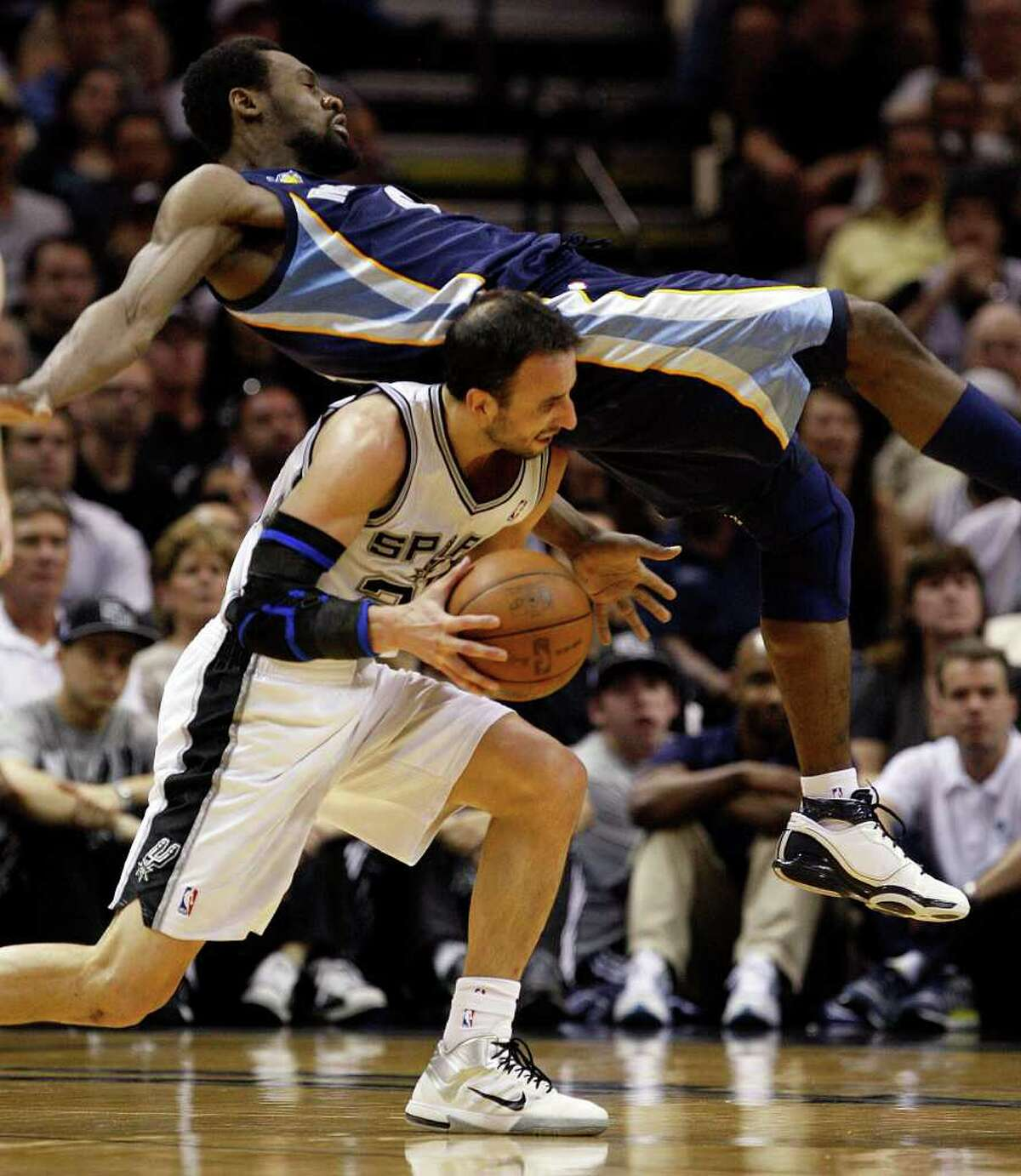 SPURS -- Memphis Grizzlies Tony Allen falls on San Antonio Spurs Manu Ginobili during the first half in the second game of the Western Conference Quarter Finals at the AT&T Center, April 20, 2011. JERRY LARA/glara@express-news.net