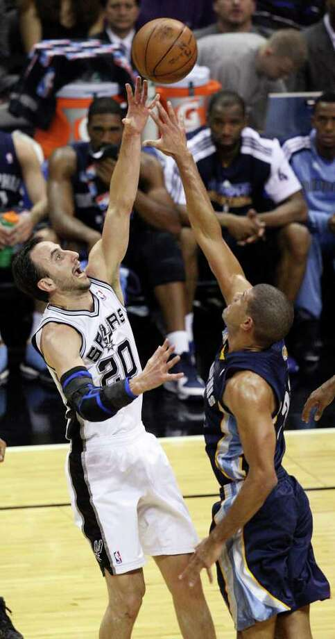 FOR SPORTS - San Antonio Spurs' Manu Ginobili shoots over Memphis Grizzlies' Shane Battier during first half action of Game 2 of the first round of the Western Conference playoffs at the AT&T Center Wednesday April 20, 2011.  (PHOTO BY EDWARD A. ORNELAS/eaornelas@express-news.net) Photo: EDWARD A. ORNELAS, SAN ANTONIO EXPRESS-NEWS / SAN ANTONIO EXPRESS-NEWS (NFS)