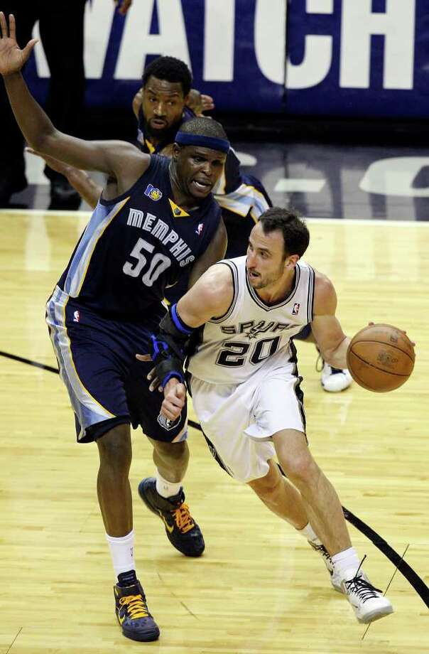 FOR SPORTS - San Antonio Spurs' Manu Ginobili looks for room around Memphis Grizzlies' Zach Randolph during second half action of Game 2 of the first round of the Western Conference playoffs at the AT&T Center Wednesday April 20, 2011. The Spurs won 93-87.(PHOTO BY EDWARD A. ORNELAS/eaornelas@express-news.net) Photo: EDWARD A. ORNELAS, SAN ANTONIO EXPRESS-NEWS / SAN ANTONIO EXPRESS-NEWS (NFS)