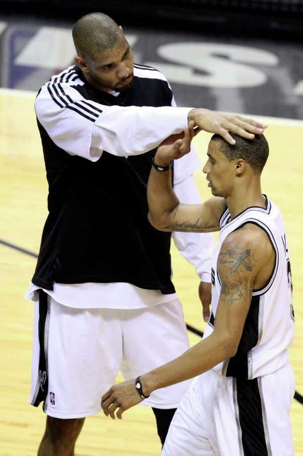 FOR SPORTS - San Antonio Spurs' Tim Duncan celebrates with San Antonio Spurs' George Hill after Game 2 of the first round of the Western Conference playoffs against the Memphis Grizzlies at the AT&T Center Wednesday April 20, 2011. The Spurs won 93-87.(PHOTO BY EDWARD A. ORNELAS/eaornelas@express-news.net) Photo: EDWARD A. ORNELAS, SAN ANTONIO EXPRESS-NEWS / SAN ANTONIO EXPRESS-NEWS (NFS)