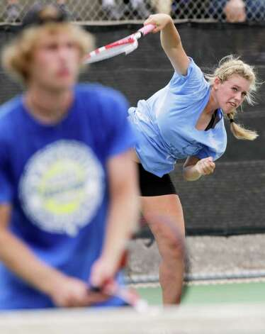 New Braunfels' Liza Fieldsend serves past her brother and team mate Beau Fieldsend during the Mixed Doubles against Reagan H. S. at the Region IV-5A tennis tournament finals at McFarlin Tennis Center, Wednesday, April 20, 2011.   Photo Bob Owen/rowen@express-news.net Photo: BOB OWEN, SAN ANTONIO EXPRESS-NEWS / rowen@express-news.net
