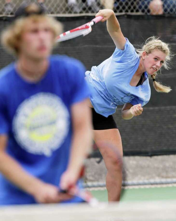 Sports daily - New Braunfels' Liza Fieldsend serves past her brother and team mate Beau Fieldsend during the Mixed Doubles against Reagan H. S. at the Region IV-5A tennis tournament finals at McFarlin Tennis Center, Wednesday, April 20, 2011.   Photo Bob Owen/rowen@express-news.net Photo: BOB OWEN, SAN ANTONIO EXPRESS-NEWS / rowen@express-news.net