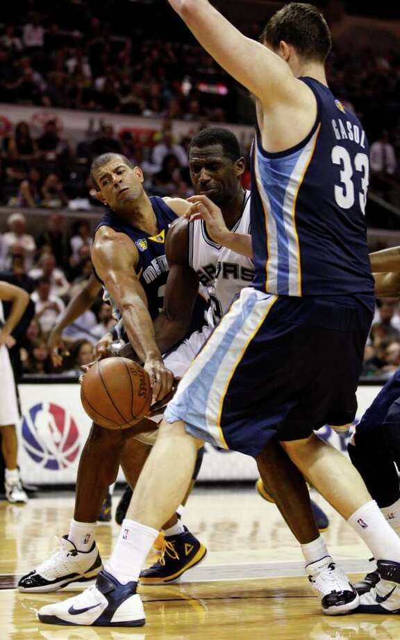 SPURS -- San Antonio Spurs Antonio McDyess gets the ball swiped by  Memphis Grizzlies Shane Battier as Marc Gasol helps during the second half in the second game of the Western Conference Quarter Finals at the AT&T Center, April 20, 2011. The Spurs won 93-87 and tie the series, 1-1. JERRY LARA/glara@express-news.net Photo: JERRY LARA, Jerry Lara/glara@express-news.net / SAN ANTONIO EXPRESS-NEWS (NFS)