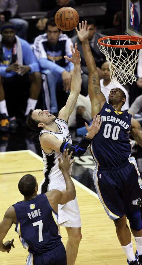 FOR SPORTS - San Antonio Spurs' Manu Ginobili shoots between Memphis Grizzlies' Leon Powe and Memphis Grizzlies' Darrell Arthur  during first half action of Game 2 of the first round of the Western Conference playoffs at the AT&T Center Wednesday April 20, 2011. Photo: EDWARD A. ORNELAS, EDWARD A. ORNELAS/eaornelas@express-news.net / SAN ANTONIO EXPRESS-NEWS (NFS)