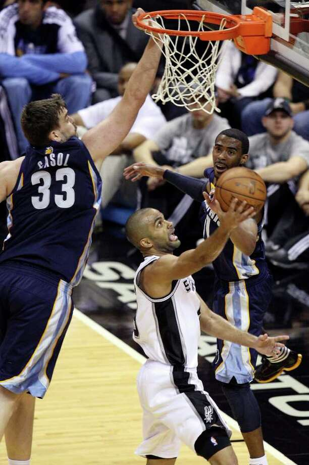 FOR SPORTS - San Antonio Spurs' Tony Parker shoots between Memphis Grizzlies' Marc Gasol and Memphis Grizzlies' Mike Conley during first half action of Game 2 of the first round of the Western Conference playoffs at the AT&T Center Wednesday April 20, 2011. Photo: EDWARD A. ORNELAS, EDWARD A. ORNELAS/eaornelas@express-news.net / SAN ANTONIO EXPRESS-NEWS (NFS)