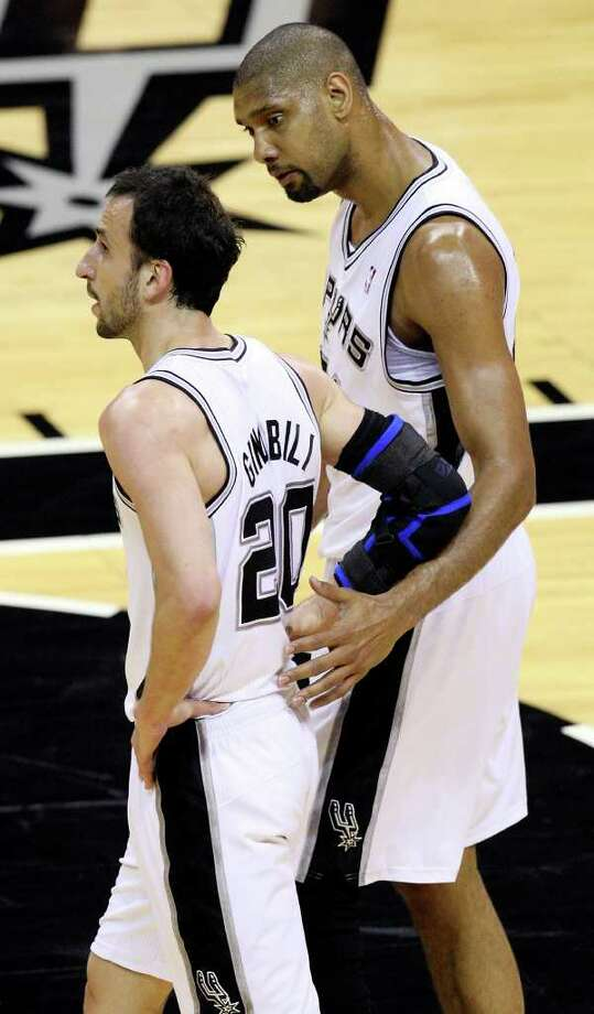 FOR SPORTS - San Antonio Spurs' Tim Duncan talks with teammate San Antonio Spurs' Manu Ginobili during first half action of Game 2 of the first round of the Western Conference playoffs against the Memphis Grizzlies  at the AT&T Center Wednesday April 20, 2011. Photo: EDWARD A. ORNELAS, EDWARD A. ORNELAS/eaornelas@express-news.net / SAN ANTONIO EXPRESS-NEWS (NFS)