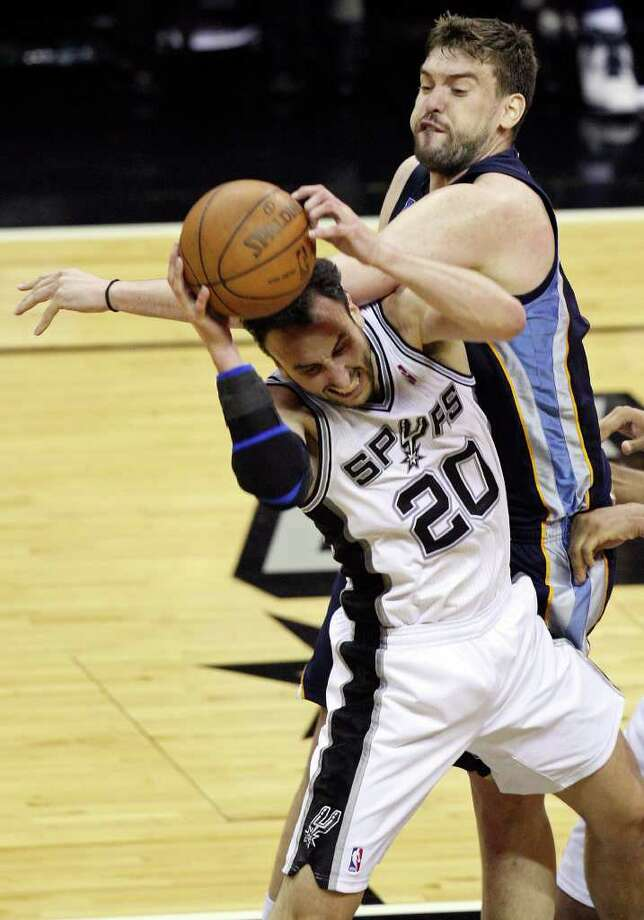FOR SPORTS - San Antonio Spurs' Manu Ginobili is fouled by Memphis Grizzlies' Marc Gasol during second half action of Game 2 of the first round of the Western Conference playoffs at the AT&T Center Wednesday April 20, 2011. The Spurs won 93-87. Photo: EDWARD A. ORNELAS, EDWARD A. ORNELAS/eaornelas@express-news.net / SAN ANTONIO EXPRESS-NEWS (NFS)