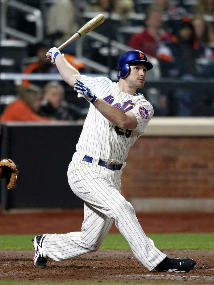 New York Mets' Daniel Murphy watches his two-run home run against the Houston Astros in the sixth inning of a baseball game in New York, Wednesday, April 20, 2011. (AP Photo/Paul J. Bereswill) Photo: Paul J. Bereswill