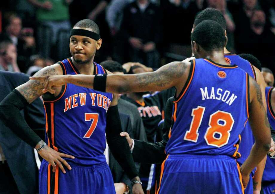 New York Knicks forward Carmelo Anthony (7), guard Roger Mason (18) and teammates huddle during a timeout against the Boston Celtics near the end of Game 2 of a first-round NBA basketball playoff series, in Boston on Tuesday, April 19, 2011. The Celtics won 96-93. (AP Photo/Elise Amendola) Photo: Elise Amendola