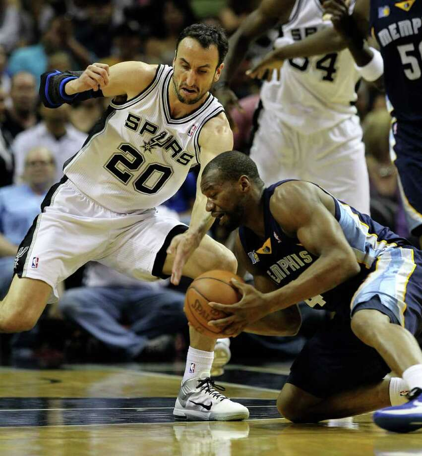 Spurs' Manu Ginobili (20) goes for a steal against Memphis Grizzlies' Sam Young (04) in the first round of the Western Conference playoffs at the AT&T Center on Wednesday, April 20, 2010. Kin Man Hui/kmhui@express-news.net Photo: KIN MAN HUI, Kin Man Hui/kmhui@express-news.net / San Antonio Express-News NFS