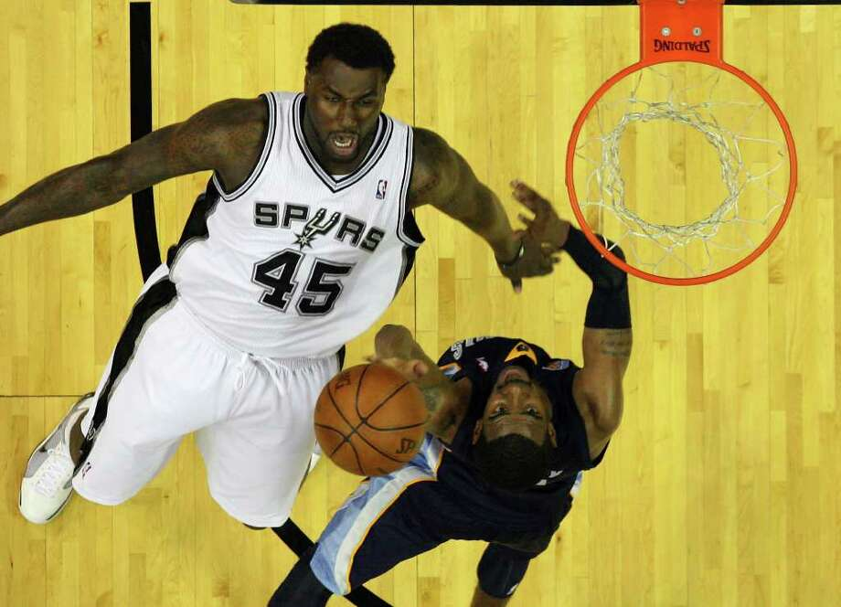 Memphis Grizzlies' Mike Conley (right) drives to the basket against Spurs' DeJuan Blair (45) in the first round of the Western Conference playoffs at the AT&T Center on Wednesday, April 20, 2010. Spurs won 98-87. Kin Man Hui/kmhui@express-news.net Photo: KIN MAN HUI, Kin Man Hui/kmhui@express-news.net / San Antonio Express-News NFS