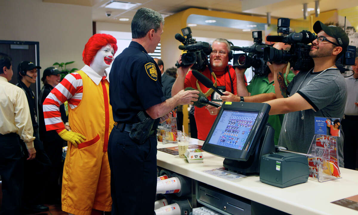 Police Chief William McManus, flanked by Ronald McDonald, speaks with television crews on Wednesday, April 20, 2011, at the McDonald's at The Rim shopping center during a news conference. McDonald's announced that it will donate a portion of all sales from 11a.m. to 2 p.m. on Friday, April 22, 2011, to the 100 Club of San Antonio.