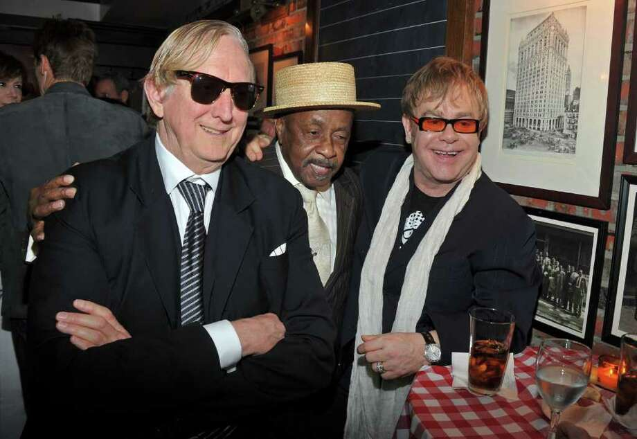 "NEW YORK, NY - APRIL 20: (L-R) Producer T-Bone Burnett,The Mighty Hannibal and Sir Elton John attend the opening night premiere of ""The Union"" at the 2011 Tribeca Film Festival at North Cove at World Financial Center Plaza on April 20, 2011 in New York City.  (Photo by Stephen Lovekin/Getty Images) *** Local Caption *** T-Bone Burnett;The Mighty Hannibal;Sir Elton John; Photo: Getty Images"