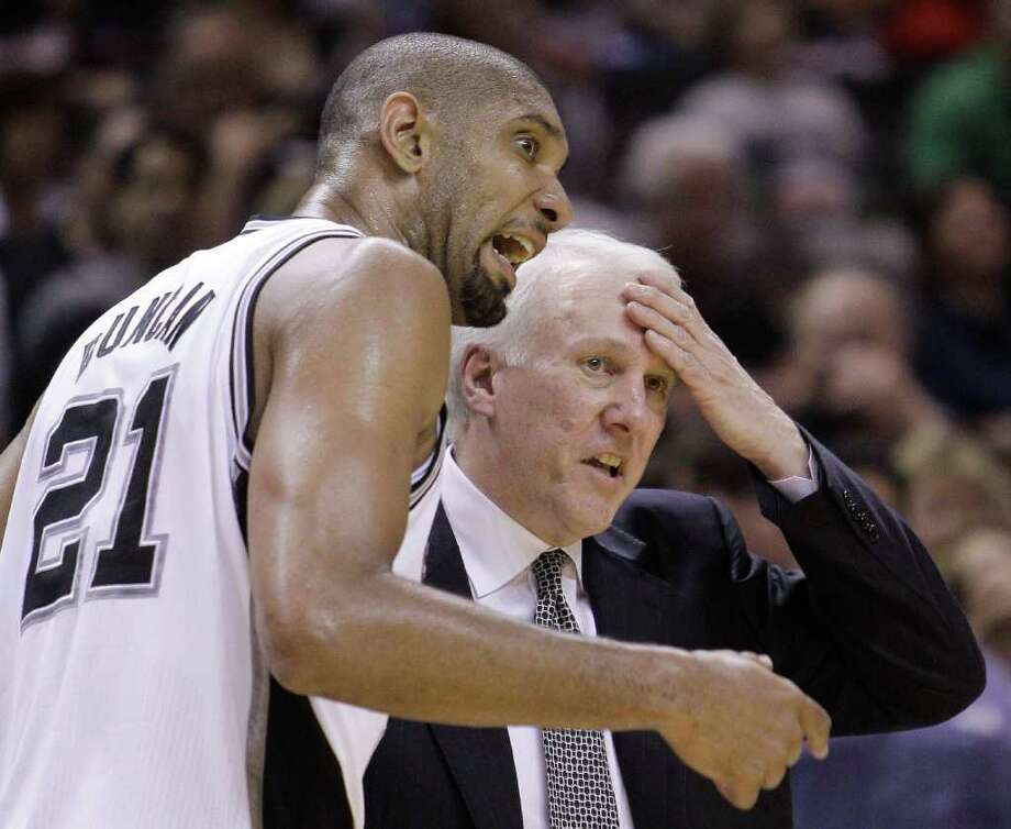 San Antonio Spurs' Tim Duncan (21) talks with Spurs coach Gregg Popovich, right, during the fourth quarter of Game 2 of a first-round NBA basketball playoff series against the Memphis Grizzlies, Wednesday, April 20, 2011, in San Antonio. Photo: AP