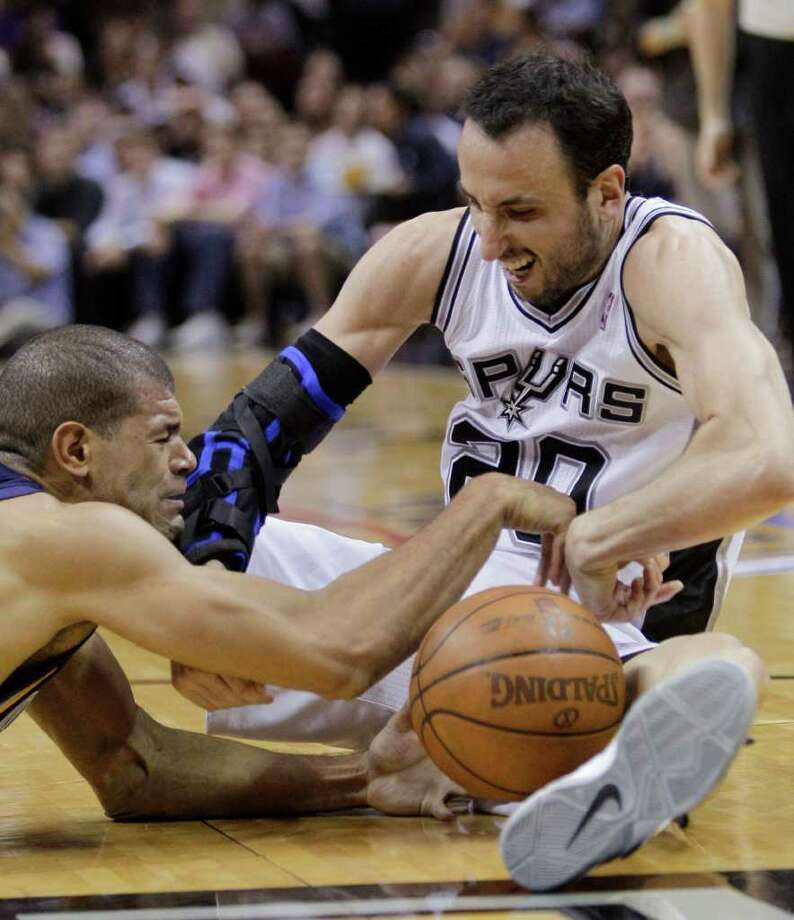 San Antonio Spurs' Manu Ginobili (20), of Argentina, and Memphis Grizzlies' Shane Battier, left, scramble for a loose ball during the second quarter of Game 2 of a first-round NBA basketball playoff series, Wednesday, April 20, 2011, in San Antonio. Photo: AP
