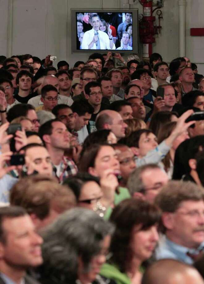 President Barack Obama is seen a a television monitor during a town hall meeting to discuss reducing the national debt, Wednesday, April 20, 2011, at Facebook headquarters in Palo Alto, Calif. Photo: AP