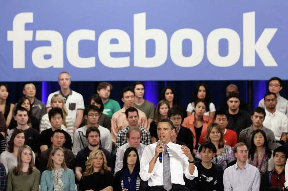 President Barack Obama  gestures during a town hall meeting at Facebook headquarters in Palo Alto, Calif., Wednesday, April 20, 2011. Photo: AP