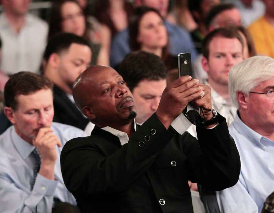 Music Rapper Stanley Kirk Burrell a.k.a., MC Hammer uses his Iphone during a town hall meeting with President Barack Obama at Facebook headquarters in Palo Alto, Calif., Wednesday, April 20, 2011. Photo: AP