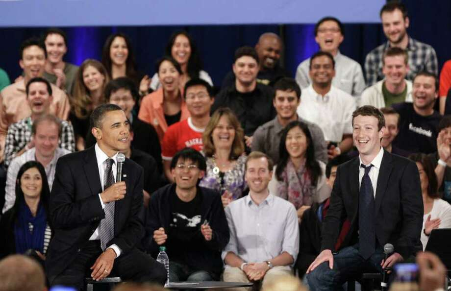 President Barack Obama and Facebook CEO Mark Zuckerberg take part in a town hall meeting at Facebook headquarters in Palo Alto, Calif., Wednesday, April 20, 2011. Photo: AP