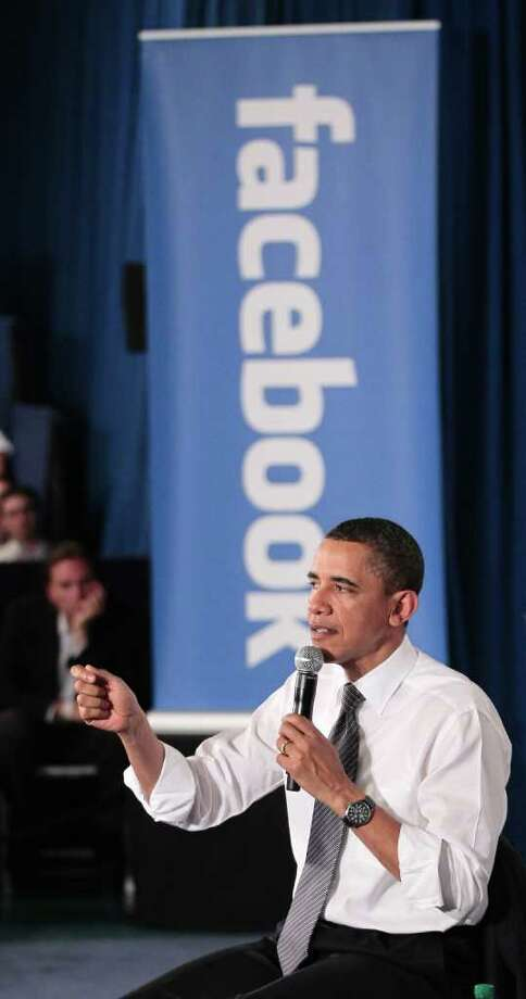 President Barack Obama gestures during a town hall meeting to discuss reducing the national debt, Wednesday, April 20, 2011, at Facebook headquarters in Palo Alto, Calif. Photo: AP